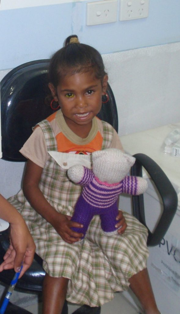 Girl given teddy bear during clinic visit